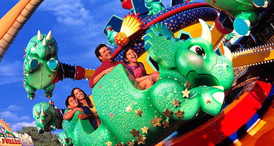 A family on the DINOSAUR attraction at Disney's Animal Kingdom Park.