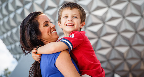 A mom and her son in front of Spaceship Earth at Epcot