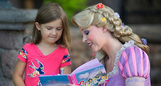 Rapunzel reads a book to a little girl