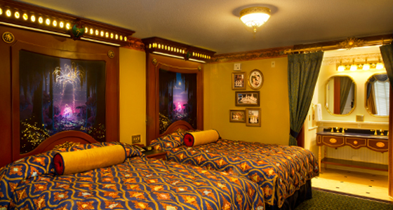 Two queen beds with headboards featuring images of festive fireworks displays in royal Guest rooms