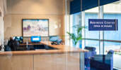 A glass enclosed Business Center with 3 computer terminals for your convenience