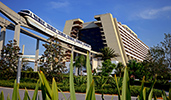 A monorail train exiting from within Disney's Contemporary Resort