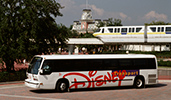 A Disney motorcoach in front of the monorail by the Main Entrance of Magic Kingdom park