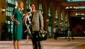 A Cast member speaking to a man in a suit inside Disneys Coronado Springs Resort