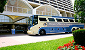 Disneys Magical Express motorcoach near a building