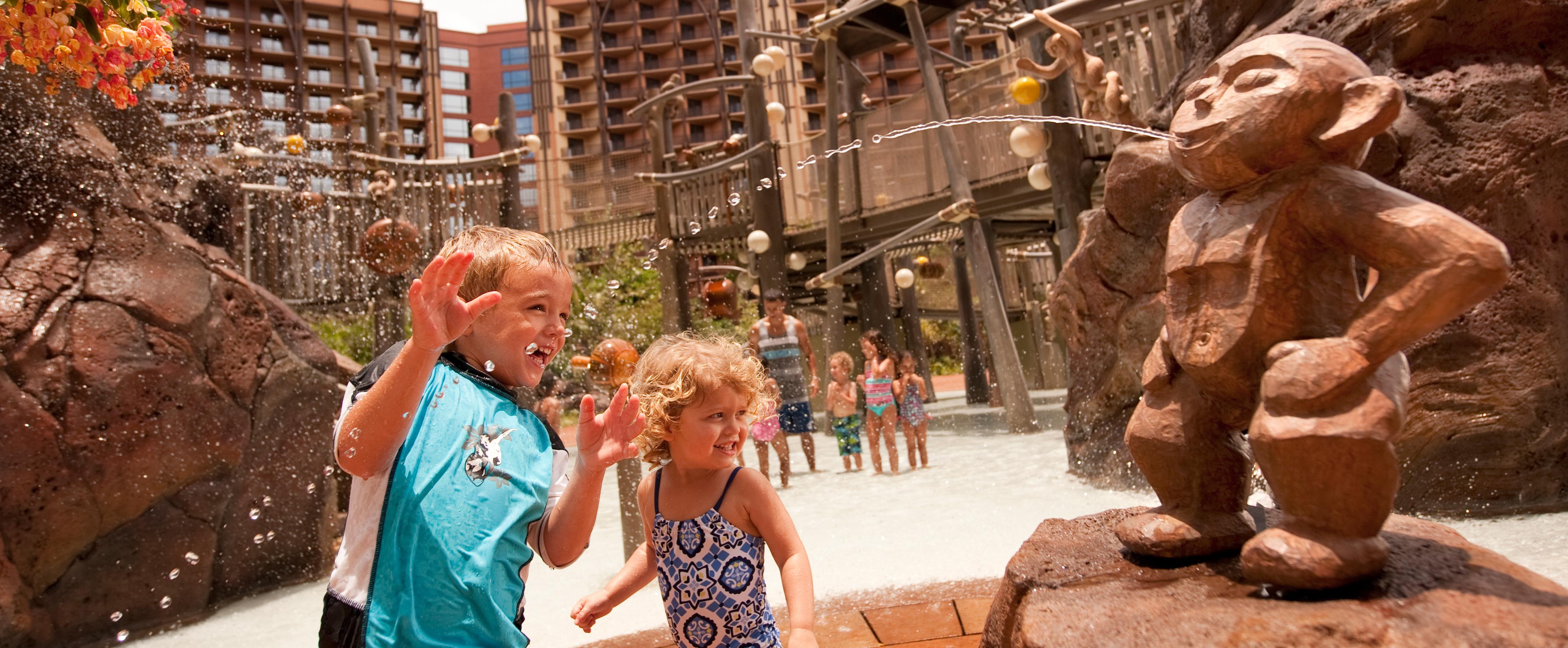 Kids play at Menehune Bridge in the Aulani pool area