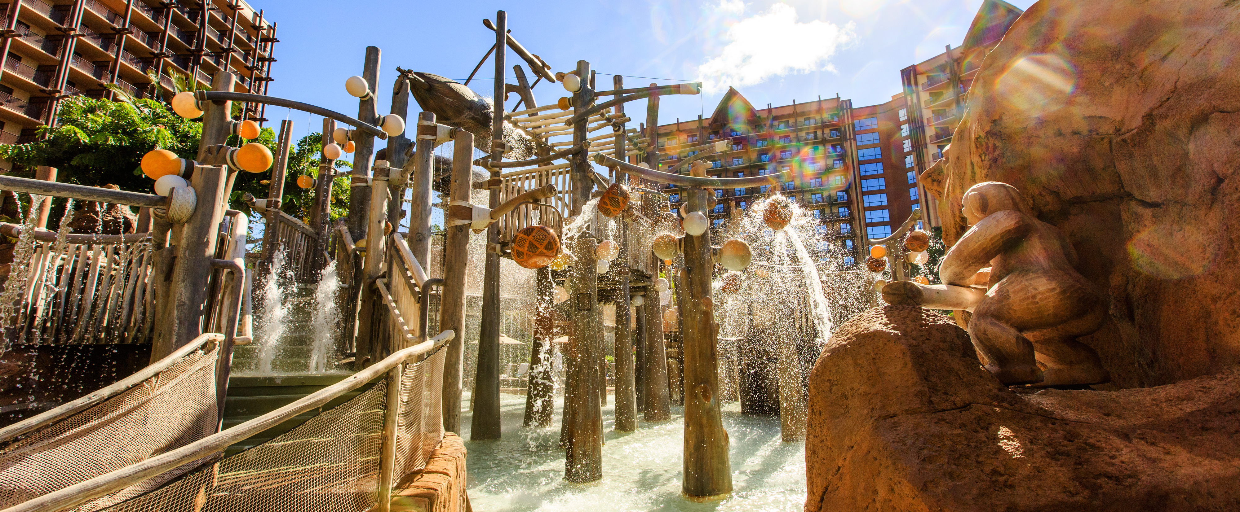 Water Spills Down From The Menehune Bridge As Resort S Rooms And Suites Tower In