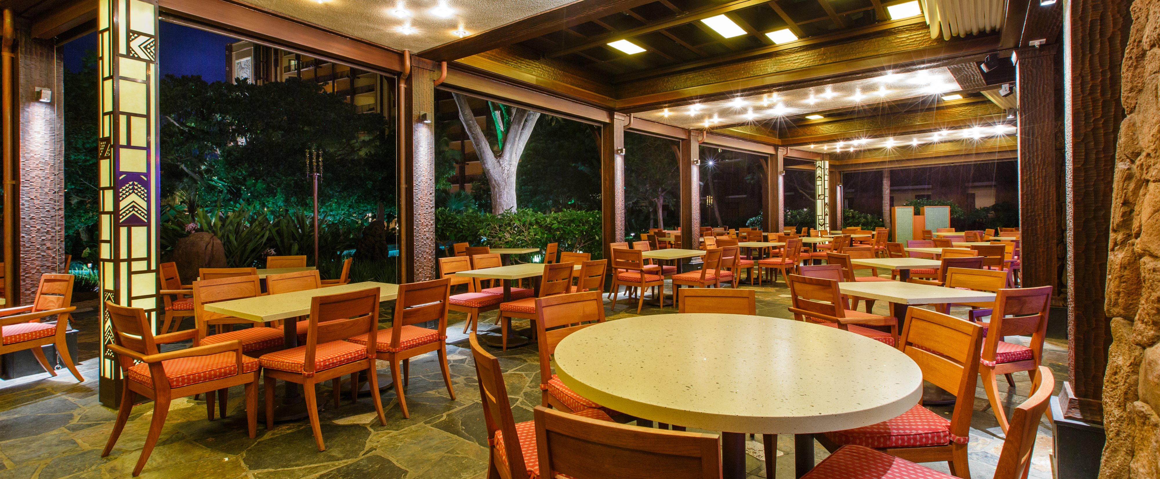... Tables On A Large Covered Patio, Lit Up At Night ...