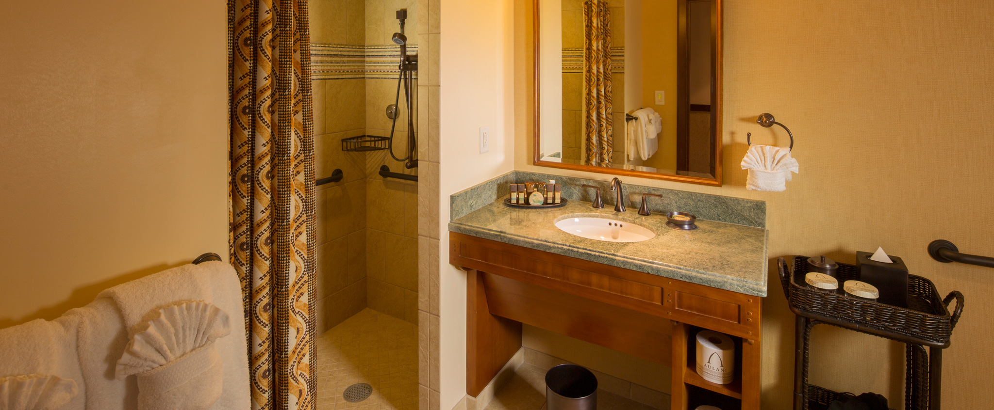 full bathrooms. A Bathroom In 2-Bedroom Suite Has Sink, Tiled Shower With Curtain Full Bathrooms E