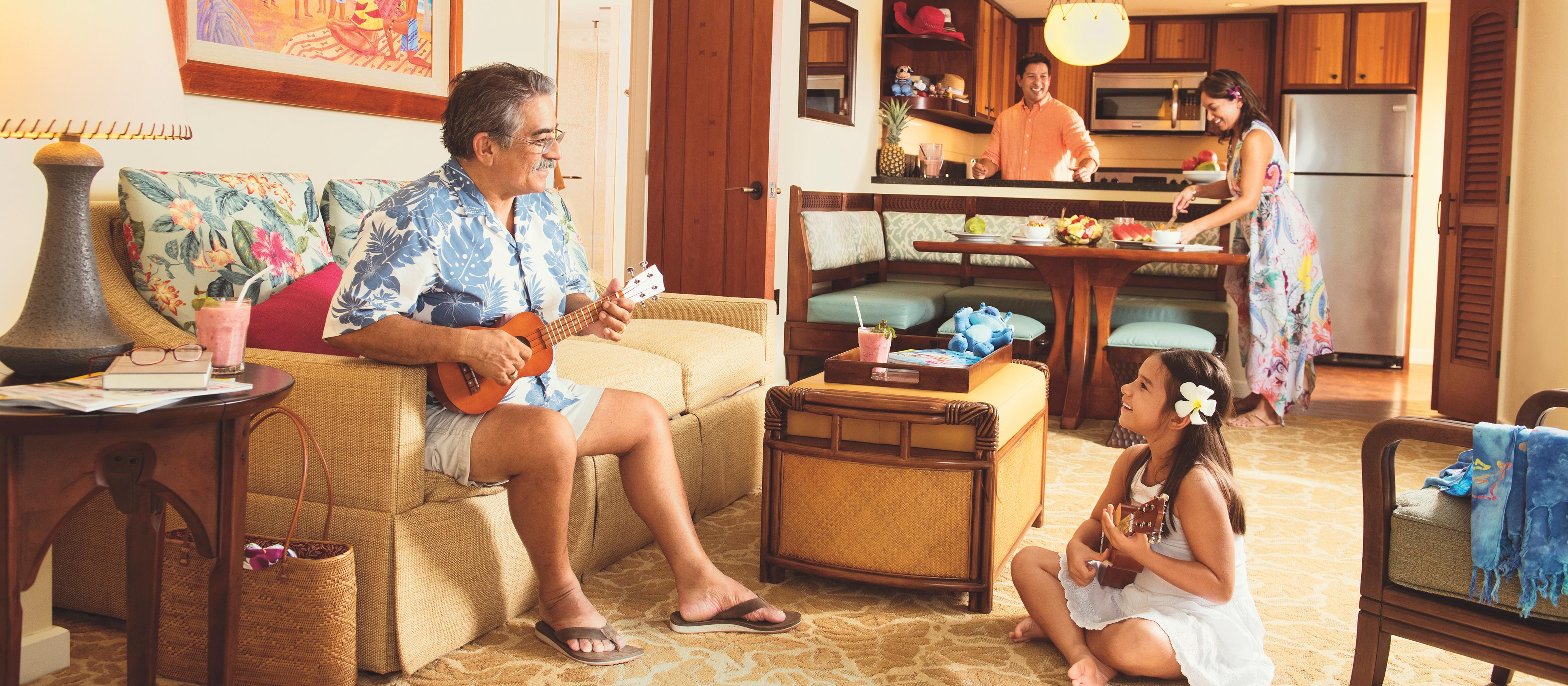 ウクレレを弾くおじいちゃんと孫、そしてキッチンとダイニングエリアで食事を用意する両親