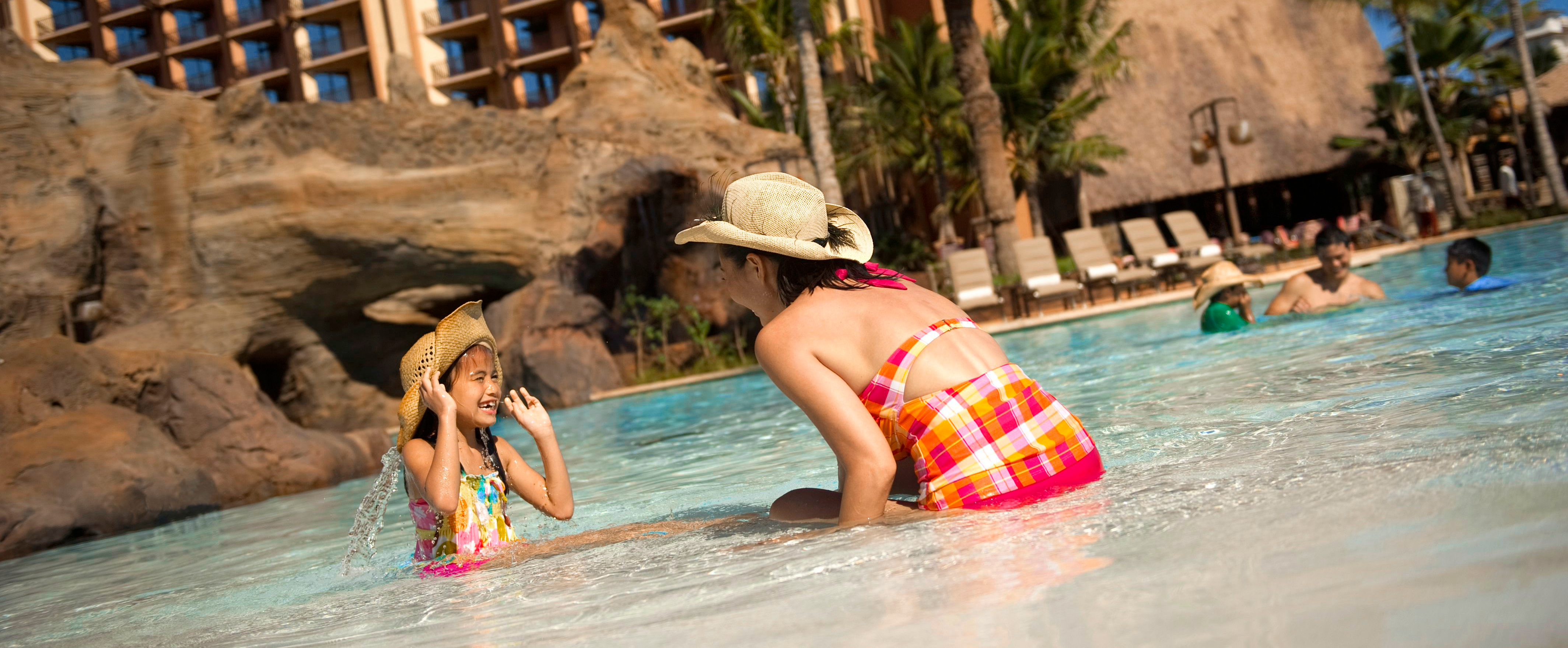 A mother and daughter play at Waikolohe Pool