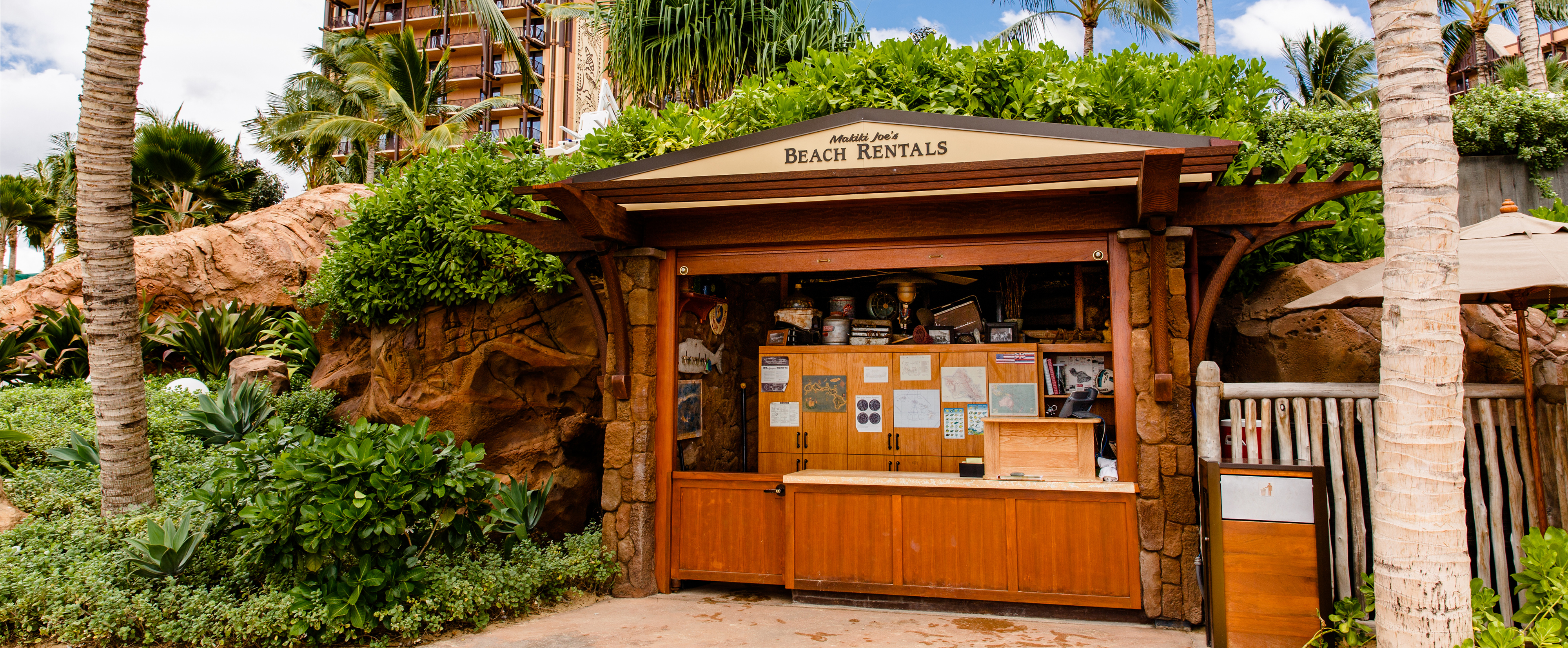 Oahu beach chair rental hawaii beach time - The Exterior Of Makiki Joe S Beach Rentals A Wooden Shack Nestled In Trees And Shrubbery