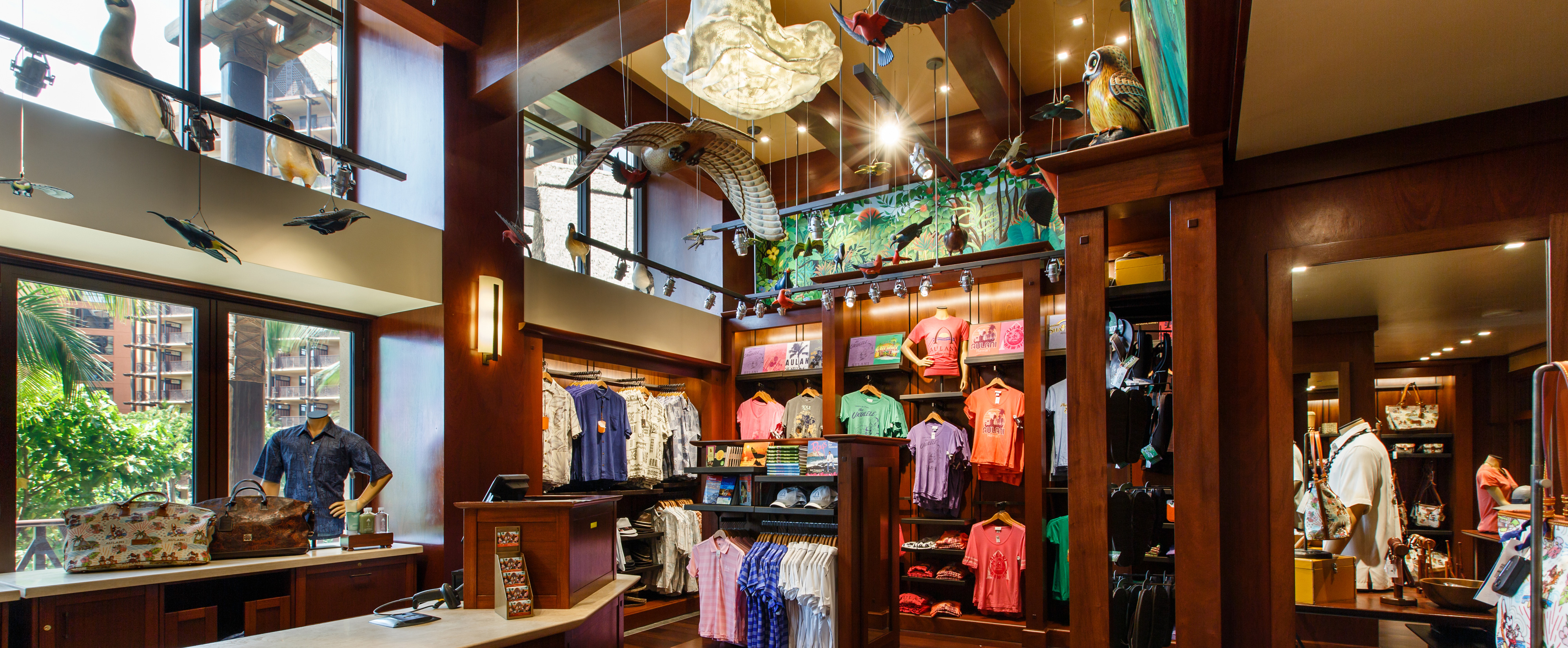 Hanging birds, apparel displays and the cash wrap counter inside Hale Manu boutique