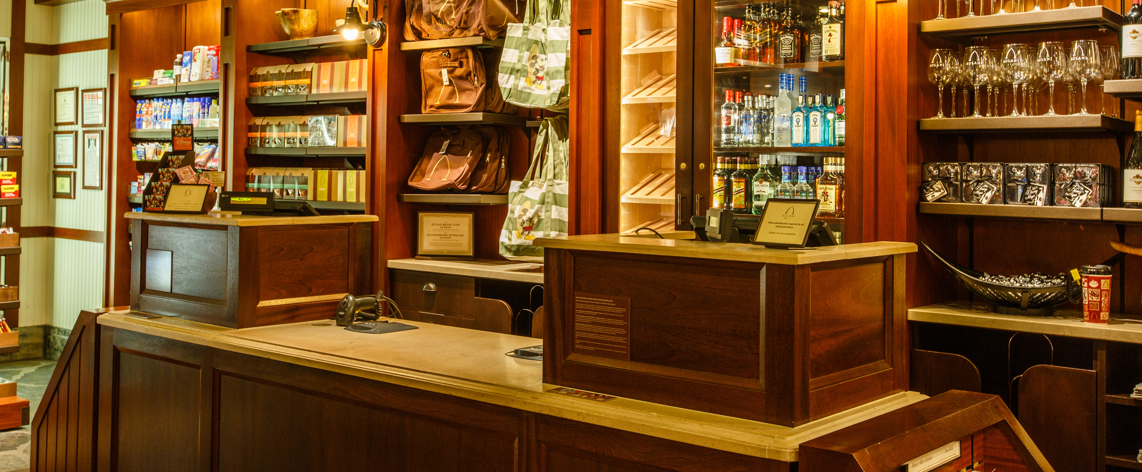 The Woodpaneled Cash Wrap Counter At Kalepa's Store, With Displays Of  Liquor,