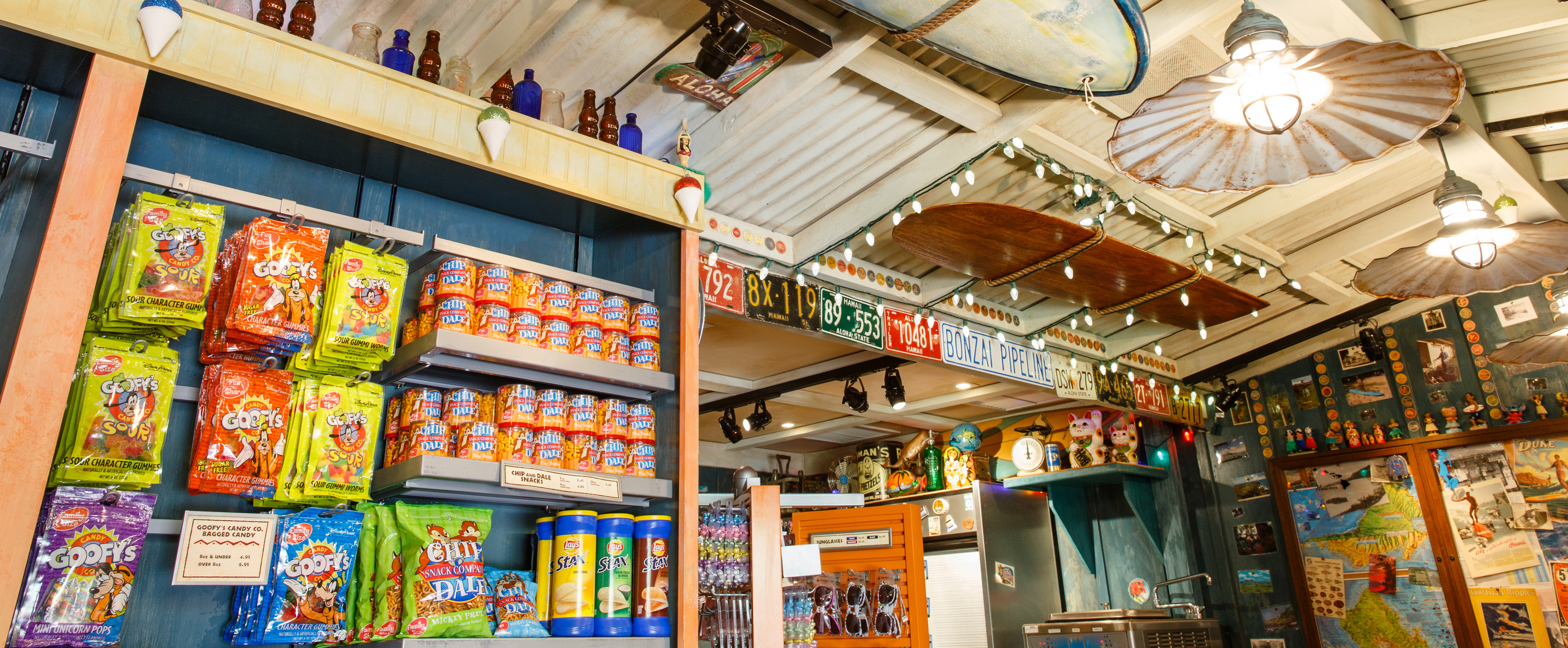 A wall display of candy, nuts, pretzels and chips at Lava Shack, with Hawaiian bric-a-brac lining the walls