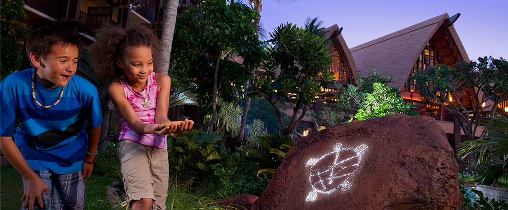 Two kids explore Aulani Resort during a scavenger hunt