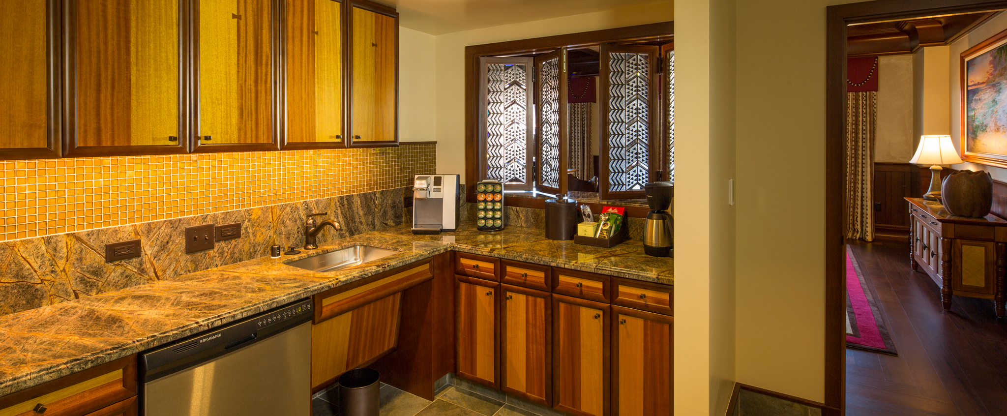 A full kitchen in the 2-Bedroom Suite includes cabinets, granite counters and stainless steel appliances
