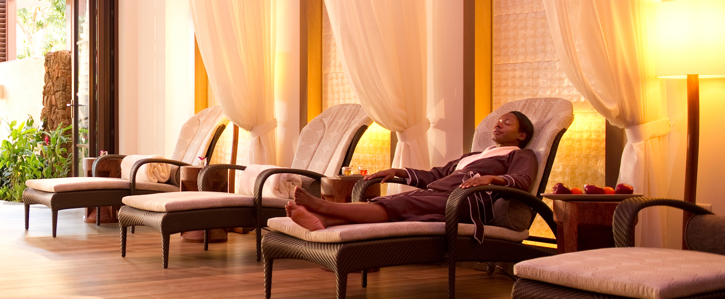 Spa lounge chair -  A Woman In A Spa Robe Relaxes In A Lounge Chair Along A Wall With White