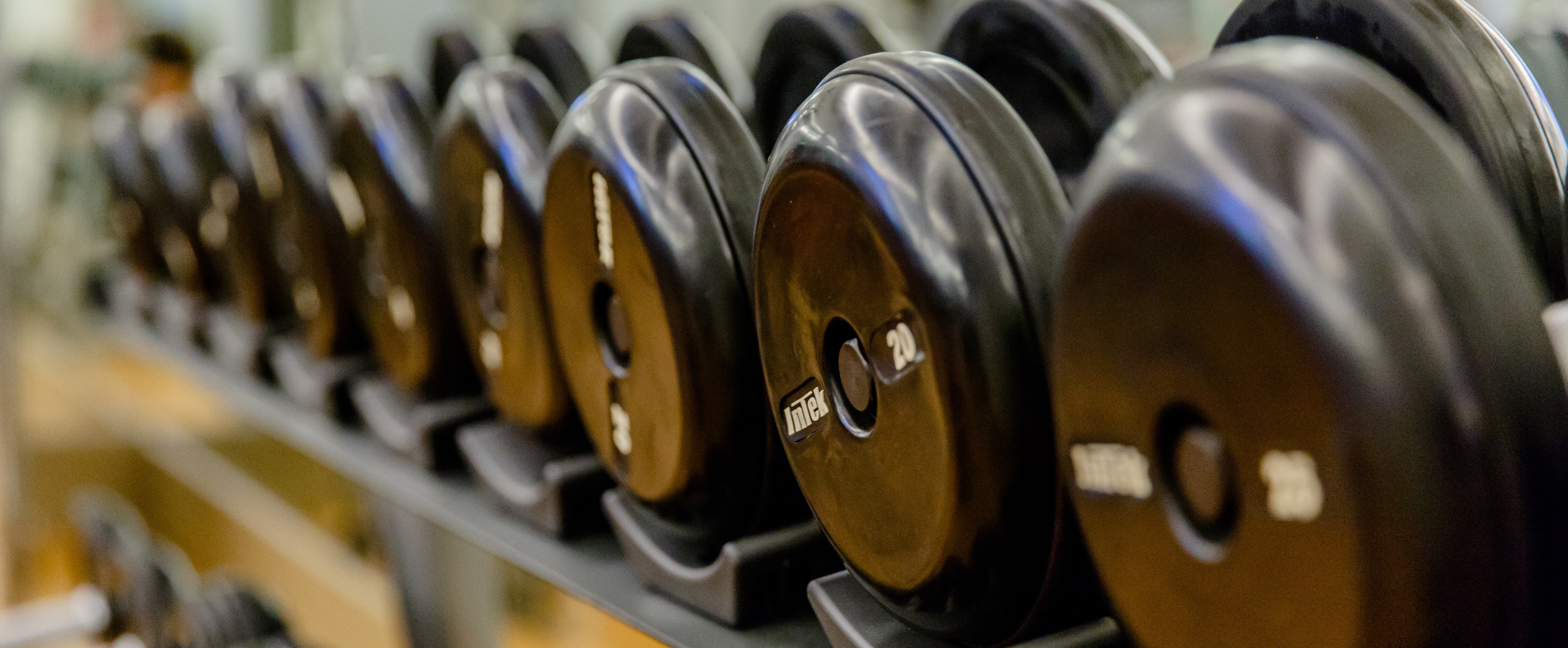 A row of racked free weights